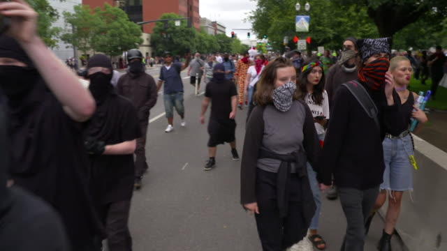 antifa protester from the anti fascist movement on a protest march in portland, oregon - portland oregon stock videos & royalty-free footage