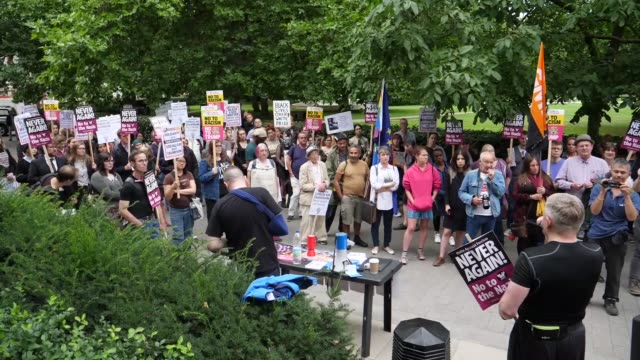 anti-fascist activists demonstrate outside the us embassy in london on august 14, 2017 after the killing of a campaigner in virginia. a car ploughed... - virginia us state stock videos & royalty-free footage