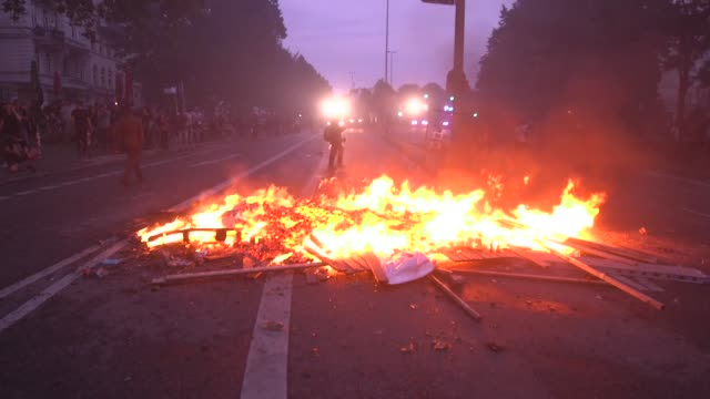 antifascist and anticapitalist black bloc g20 protesters build a burning roadblock in the altona nord neighborhood of the german city of hamburg... - group of 20 stock videos & royalty-free footage