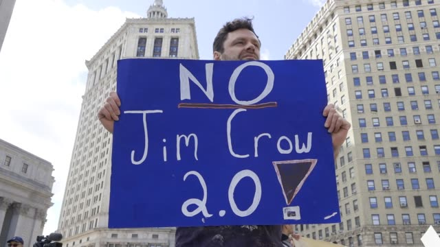 antifascist and antitrump activist rallied at foley square in the civic area of downtown manhattan advocating for socialism and against capitalism... - jim crow laws stock videos & royalty-free footage