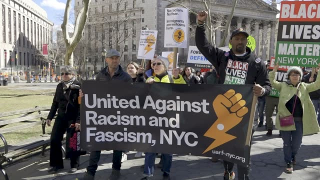 antifascist and antitrump activist rallied at foley square in the civic area of downtown manhattan advocating for socialism and against capitalism... - anti fascism stock videos & royalty-free footage