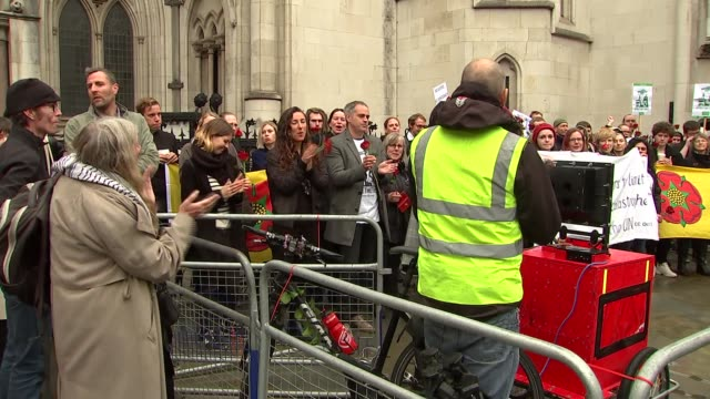 AntiFracking protest outside High Court ENGLAND London EXT Unidentified woman addressing antifracking protesters outside High Court / various of...