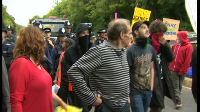 anti-fracking protesters march ahead of police officers - protesta anti fracking video stock e b–roll