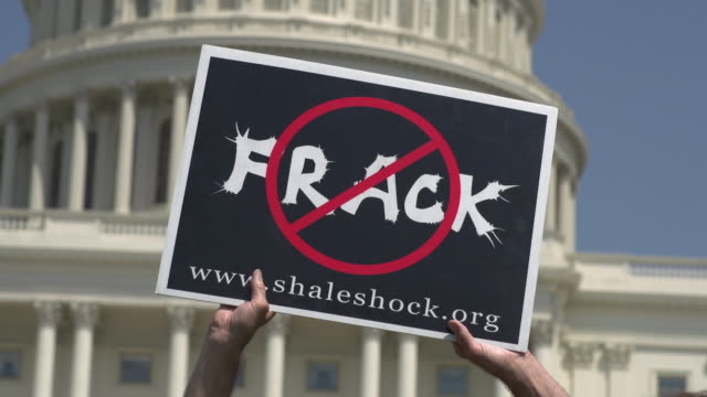 anti-fracking sign at rally at us capitol on july 28, 2012 in washington, dc - protesta anti fracking video stock e b–roll