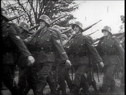 antigerman postwar propaganda nazi german soldiers marching dead bodies lying in street including young women women do heil hitler salute upset young... - soldat stock-videos und b-roll-filmmaterial