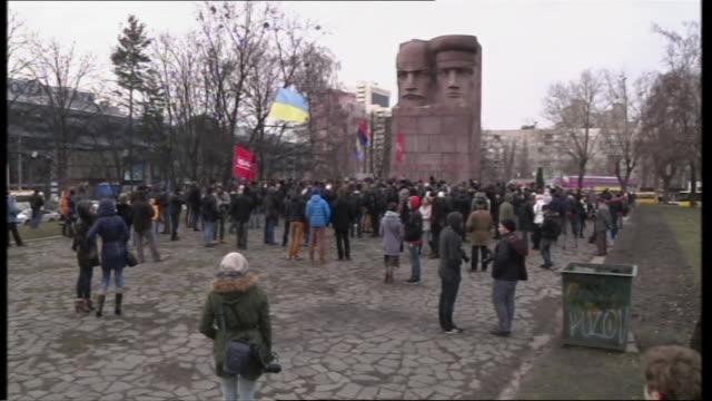 AntiGovernment activists defacing KGB monument in Kiev