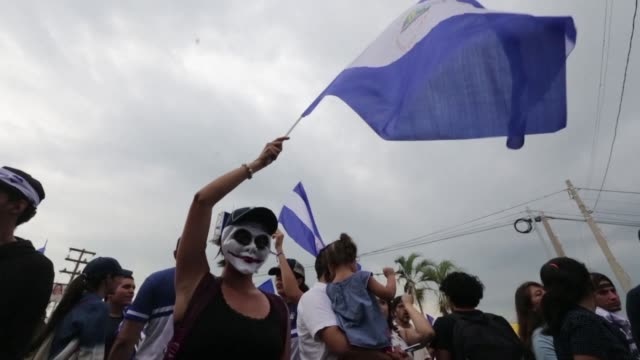 anti-government demonstrators hold a protest in managua demanding that nicaraguan president daniel ortega and his wife vice president rosario murillo... - managua stock videos & royalty-free footage