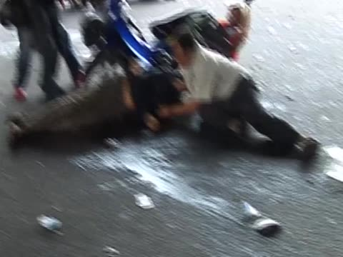 antigovernment protester on floor after being shot by armed forces battle following violent clashes thailand 17 may 2010 - violence stock videos & royalty-free footage