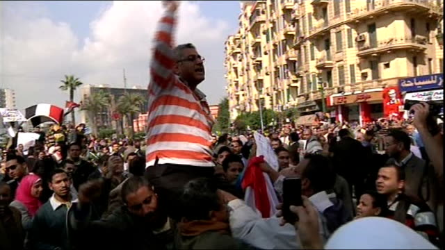 antigovernment protesters call for general strike as they continue to defy curfew vox pop antipresident mubarak protester egyptian muslim men... - removal man stock videos & royalty-free footage
