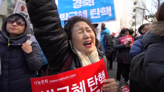 Antigovernment protesters celebrate the dismissal of South Korean President Park GeunHye as country's top court upholds her impeachment by parliament...
