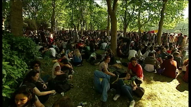 antigovernment protesters clash with police gezi park ext general views of protesters sitting in park protester wearing 'v for vendetta' mask various... - istanbul stock-videos und b-roll-filmmaterial