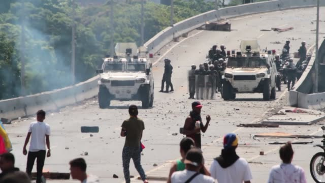 anti-government protesters clash with the venezuelan military in caracas. opposition leader juan guaido earlier encouraged venezuelan's to protest... - venezuela stock videos & royalty-free footage