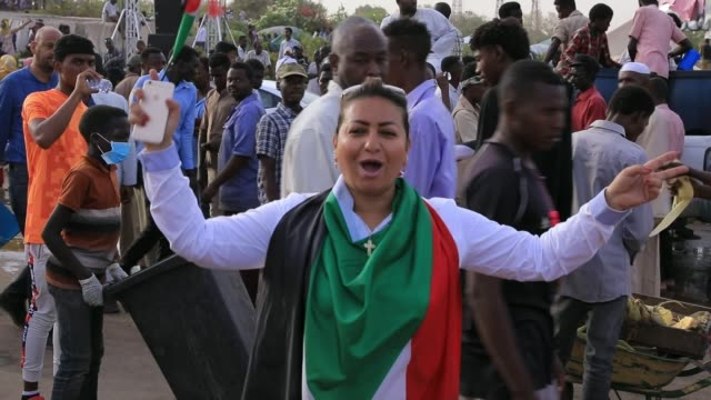 Antigovernment protesters demand recognition of women's rights SUDAN Khartoum EXT Vox pop Woman chanting SOT Woman filming protest Vox pop DAY...