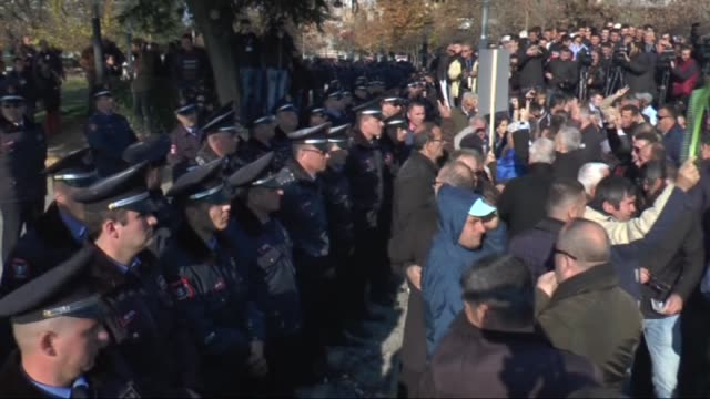 antigovernment protesters in albania have pelted police with tomatoes eggs and smoke flares during a rally near parliament in tirana on december 17... - tirana stock videos & royalty-free footage