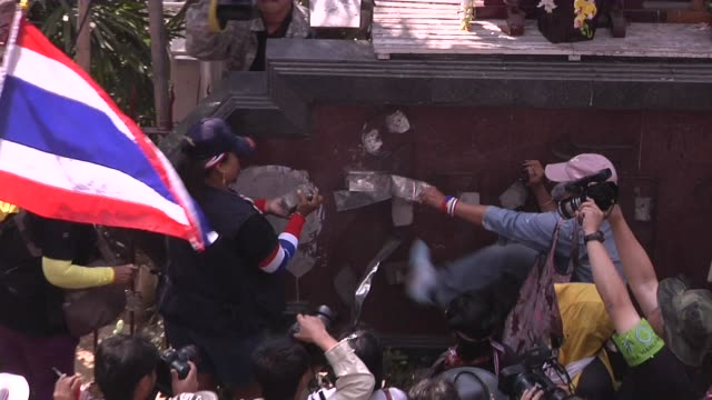 anti-government protesters vandalise the exterior of the royal thai police headquarters on the first day of the government declared state of... - vandalism stock videos & royalty-free footage