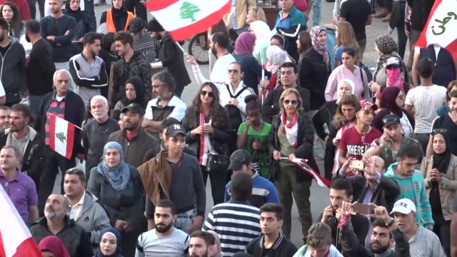 anti-government protestors in beirut celebrated the resignation of the prime minister, while pro-hariri protesters demanded resignation of other top... - 2019 stock videos & royalty-free footage