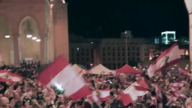 anti-government protestors in beirut celebrated the resignation of the prime minister, while pro-hariri protesters demanded resignation of other top... - lebanon country stock videos & royalty-free footage
