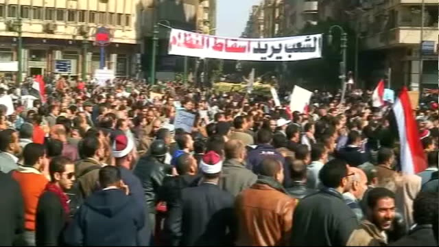 anti-government protests: clashes between protesters and mubarak supporters; mubarak supporters marching with flags and banners pro-mubarak... - egypt stock videos & royalty-free footage