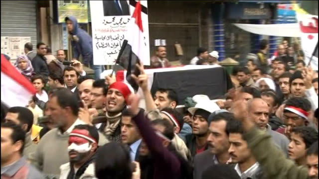 anti-government protests enter their third week; egypt: cairo: tahrir square: ext anti-government protesters chanting at 'mock funeral' in tahrir... - barricade stock videos & royalty-free footage