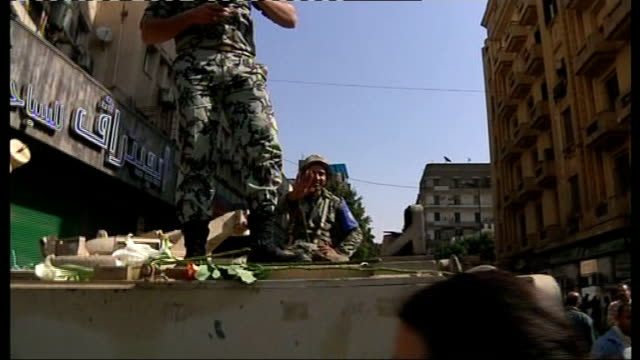 anti-government protests: president mubarak makes television address; egypt: cairo: tahrir square: ext vast crowd of anti-government protesters... - top of the pops stock-videos und b-roll-filmmaterial