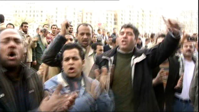 anti-government protests: protests continue; egypt: cairo: ext silhouette of man waving egyptian flag with sun high in sky man with bandage around... - arab spring stock videos & royalty-free footage