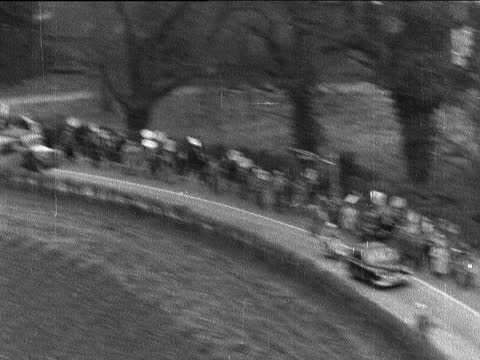 anti-h-bomb march arrives at destination; 5.55 story on end of 10.46 story england: aldermaston: air view march and cars nearer air view crowd and... - itv evening bulletin stock videos & royalty-free footage