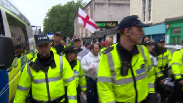 anti-immigration demonstration and rival protesters in bristol; **beware swearing / bad language heard** police officers charging along street /... - bristol england stock videos & royalty-free footage