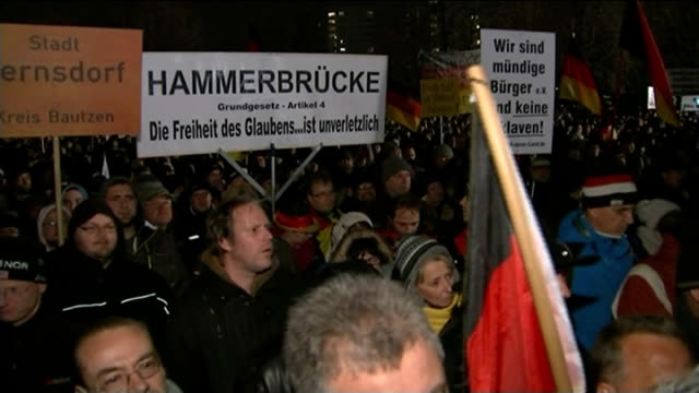 AntiIslamic protesters take to the streets GERMANY Saxony Dresden Protesters along in march Demonstrators with flags Protesters away Protesters...