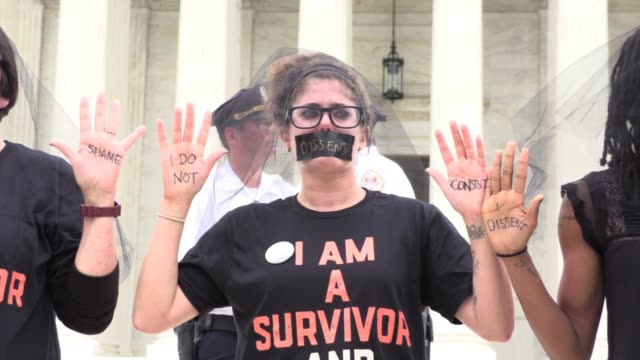AntiKavanaugh protestors silent vigil of sexual assault survivors on steps of Supreme Court Washington DC