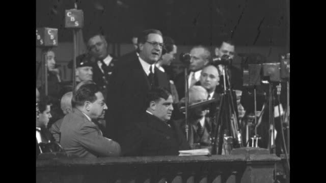 vídeos y material grabado en eventos de stock de anti-nazi rally and mock trial of adolf hitler organized by the american jewish congress at madison square garden / overhead large crowd in hall /... - fascismo