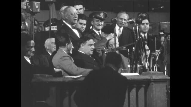 anti-nazi rally and mock trial of hitler organized by the jewish american congress at madison square garden / overhead large crowd in hall / crowd... - nazism stock-videos und b-roll-filmmaterial