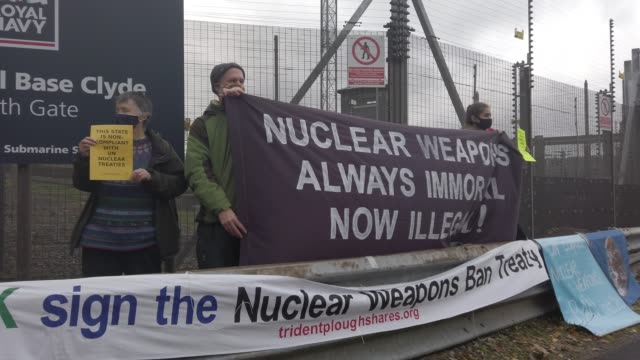 anti-nuclear campaigners hold banners and placards outside her majesty's naval base, clyde, on october 25, 2020 in faslane, scotland. protestors hold... - placard stock videos & royalty-free footage