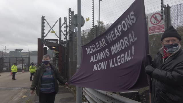 anti-nuclear campaigners hold banners and placards outside her majesty's naval base, clyde, on october 25, 2020 in faslane, scotland. protestors hold... - military base stock videos & royalty-free footage