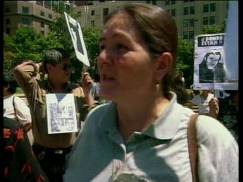 anti-pinochet demonstrators hold up placards with photos of people still missing after pinochet's regime; jan 00 - missing people stock videos & royalty-free footage