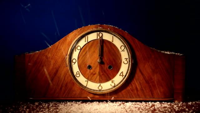 antique clock strikes twelve. - midnight stock videos and b-roll footage