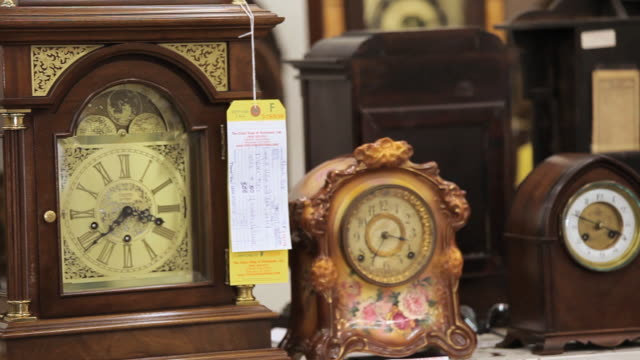 CU PAN Antique clocks in shop / Richmond, Virginia, USA.