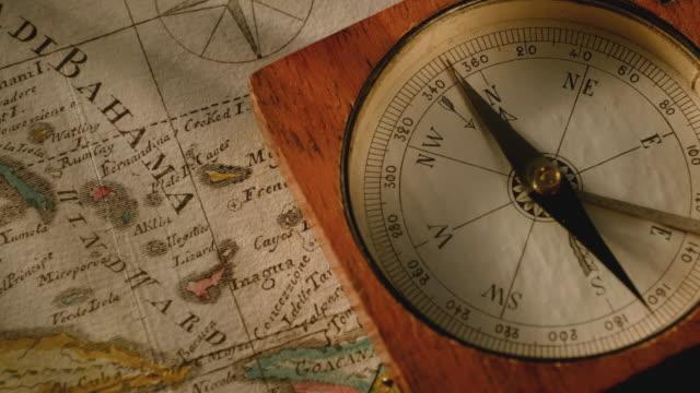 antique compass on map - 骨董品点の映像素材/bロール