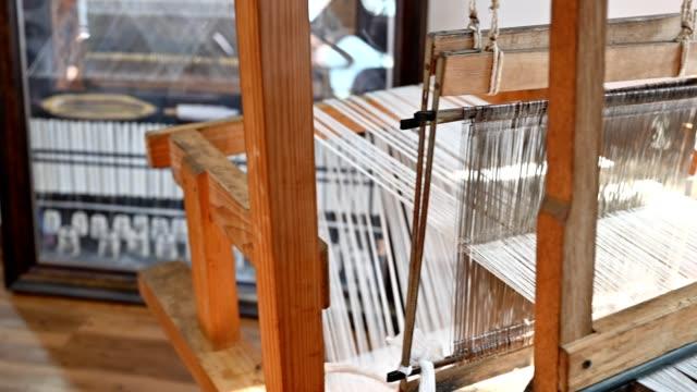 antique traditional weaving yarn on wood loom - loom stock videos & royalty-free footage