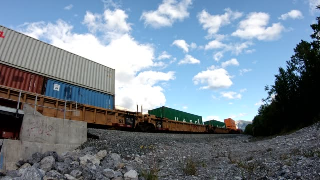 antique train long freight with container loading running on railway passing  in valley at calgary - sending stock videos & royalty-free footage