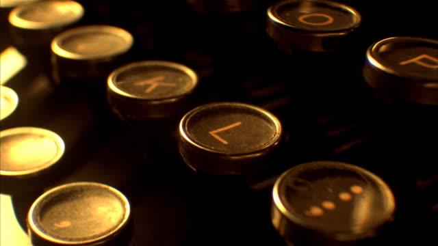 antique typewriter keys moving across screen - typewriter keyboard stock videos & royalty-free footage