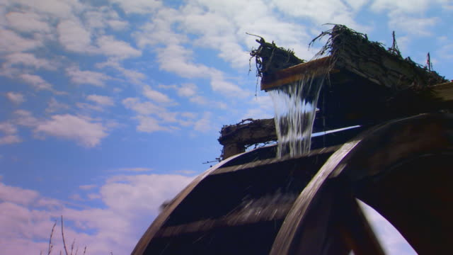 antique waterrad (water wheel) at dutch village, slow motion - water wheel stock videos and b-roll footage