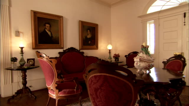 Antiques decorate a room in a plantation house. Available in HD.