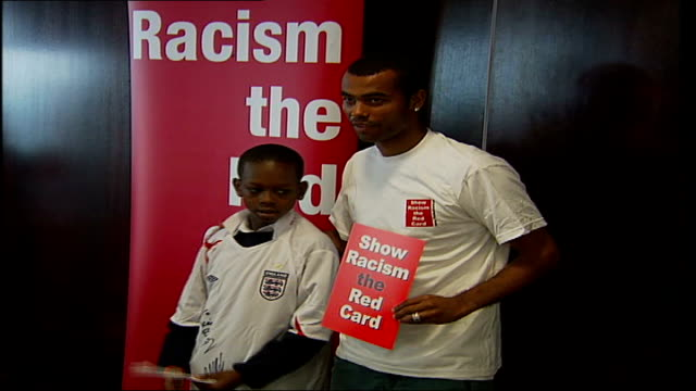 ashley cole meets schoolchildren **beware england london stamford bridge int ashley cole at 'show racism the red card' event with arm around boy at... - card table stock videos & royalty-free footage