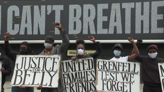 antiracism demonstrators bring flowers and pose with signs in front of a billboard reading 'i can't breathe' written with 3000 names of people who... - i can't breathe stock videos & royalty-free footage