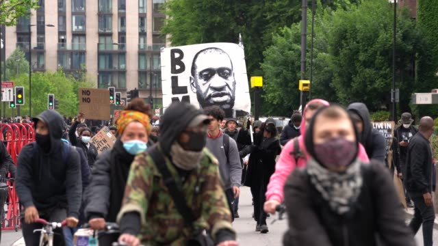 anti-racism protesters gather at the us embassy during a black lives matter march through central london on june 6, 2020 in london, united kingdom.... - social issues stock videos & royalty-free footage