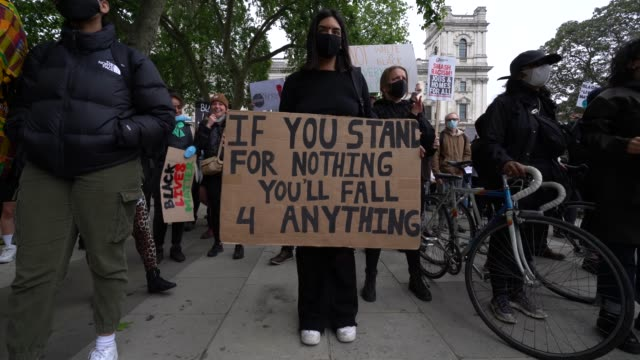 anti-racism protesters gather in parliament square during a black lives matter march through central london on june 6, 2020 in london, united... - social issues stock videos & royalty-free footage