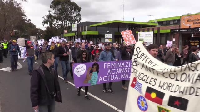 antirefugee protesters march with posters and australian flags during pro and anti refugee rallies in eltham melbourne australia on november 05 2016... - patriotism stock videos & royalty-free footage