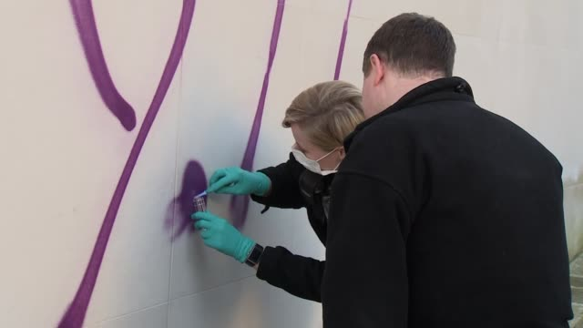 antisemitic graffiti daubed on north london synagogue and shops england london hampstead ext various of police forensic officers collecting paint... - religious equipment stock videos & royalty-free footage