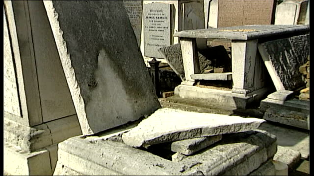 mps call for urgent action to tackle increase in anti-semitism in the uk; england: london: west ham: ext gravestones in jewish graveyard desecrated... - cemetery stock videos & royalty-free footage