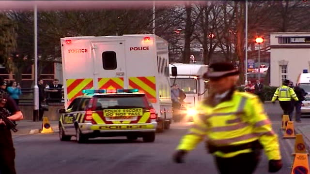 police given seven more days to question nine men evening prison van away with police escort armed police officers in the foreground pan sot coventry... - convoy stock videos & royalty-free footage